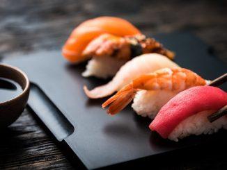 close up of sashimi sushi set with chopsticks and soy